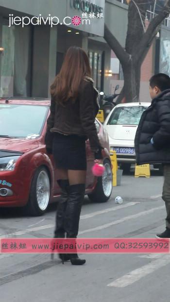 街拍穿长靴子的美女7