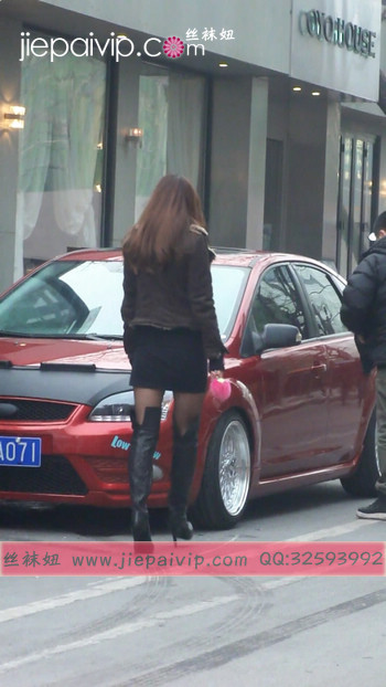 街拍穿长靴子的美女9